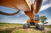 stock photo of excavator  - yellow excavator at construction site - JPG