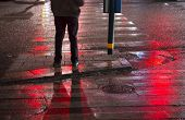 pic of wet feet  - Legs and feet of man waiting to cross street