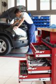 image of auto repair shop  - mechanic working on car engine - JPG