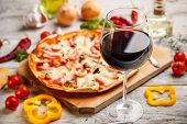picture of hot fresh pizza  - Dinner with wine and pizza - JPG