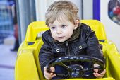 Little Toddler Boy On Car On Playground