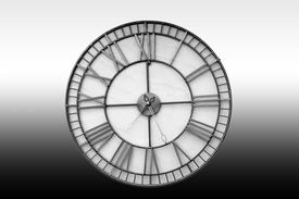 foto of homogeneous  - The close up of an isolated wall clock in front of a homogeneous background - JPG