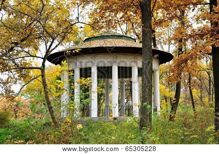 Autumn landscape. An old park gazebo in autumn.