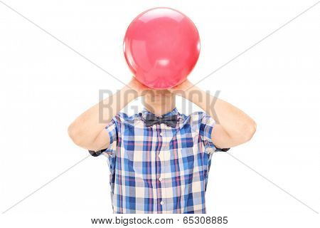 Man blowing a balloon isolated on white background