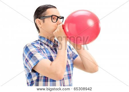 Young man blowing up a balloon isolated on white background