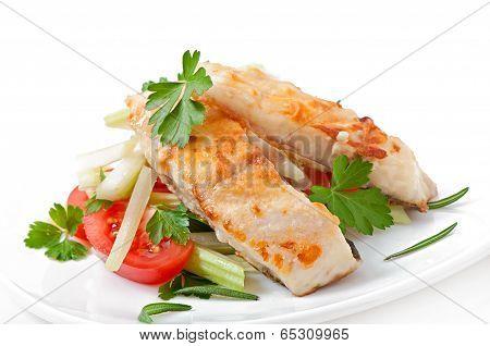 Fried filet fish and fresh vegetable salad