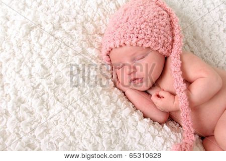 Newborn baby girl sleeping.