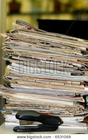 Heap Of Newspapers And Magazines