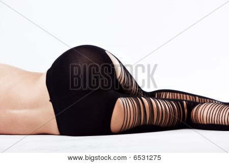 Lady In Black Stockings Isolated On White