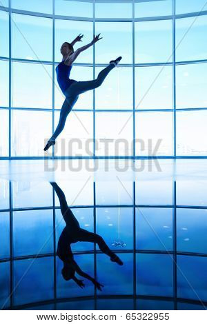 Image of slim girl stretching arms and legs in jump in the air