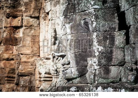Angkor Wat Cambodia. Bayon temple in Angkor Thom historical place. Human face and figures murals and carvings