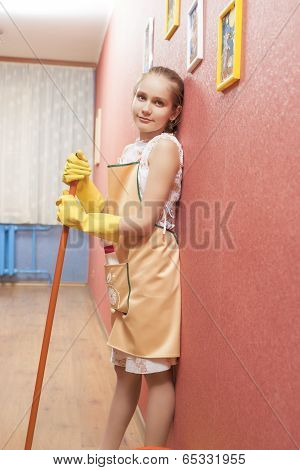 Portrait Of Little Teenage Girl With Mop