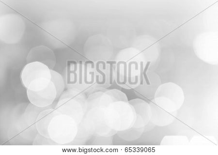 Light Silver Abstract Christmas Background With Glowing Magic Bokeh.  Christmas Background. High Res