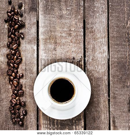 Espresso Coffee Cup And Roasted  Coffee Beans On Old Wooden Table With Copyspace,  Top View. Coffee