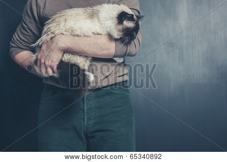 Young Man Holding A Big Cat