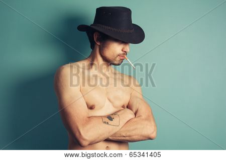 Sexy Young Cowboy Smoking Cigarette