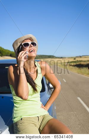 Woman Talking On  Cellphone During Summer Car Travel