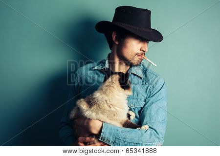 Young Cowboy With Cat Is Smoking