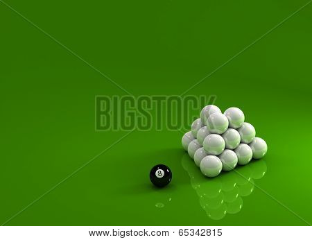 Eight ball laying next to a pyramid of white pool balls