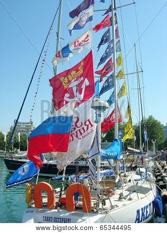 Sailship Akela with small flags  in  port of Sochi.