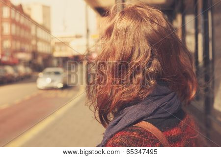 Young Woman At Bust Stop