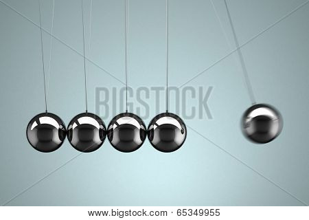 Close-up view of a Newton's Cradle with motion blur