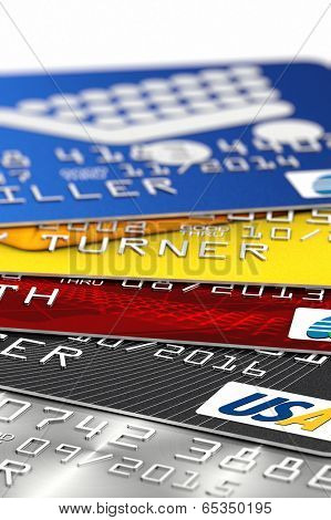 A stack of fictitious credit card with selective focus. All logos, banks and names are fake and not real.
