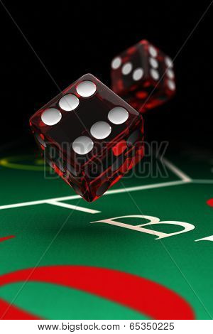 Two dice over a craps table with selective focus
