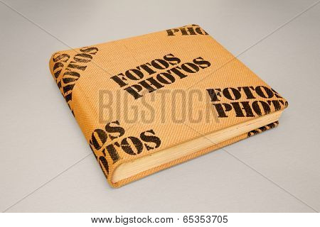 Photo album cover made from burlap with stamped on terms Fotos and Photos on it