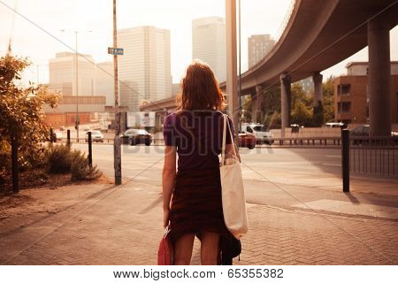 Young Woman Walking By The Roadside