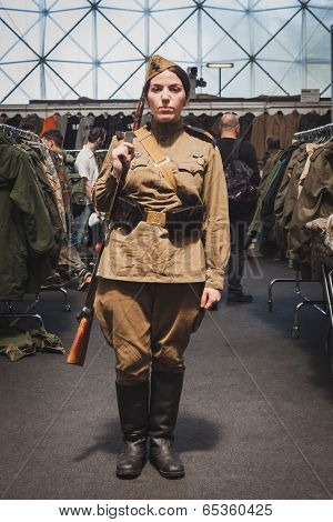Woman In Vintage Russian Uniform At Militalia In Milan, Italy