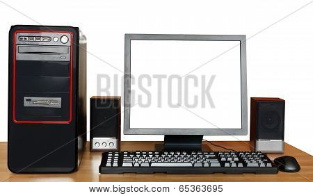 Black Computer On Wooden Table