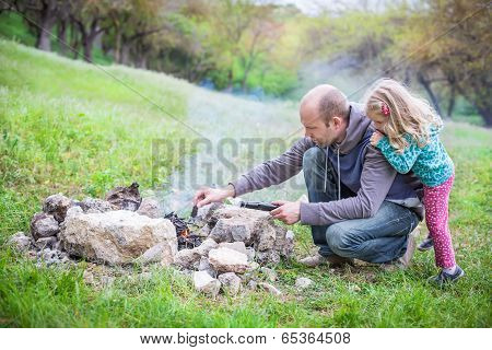 Father And Daughter On The Nature