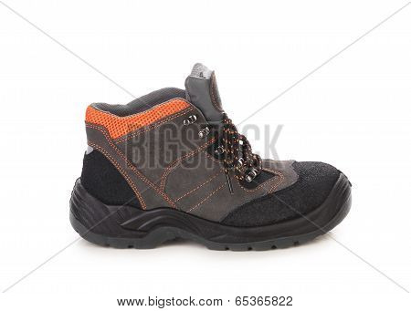 Black man's boot with orange inset.