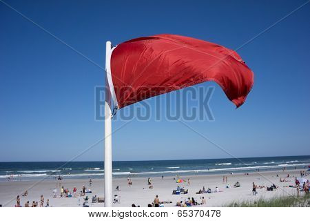 JACKSONVILLE BEACH, FL-MAY 17, 2014: Red warning flag at Jacksonville Beach on a weekend. Jacksonville Beach is 15 miles east of Jacksonville and has a population of 21,362 at the 2010 census.
