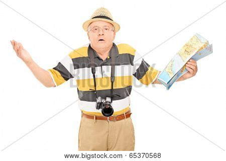 Confused mature tourist holding a map isolated on white background