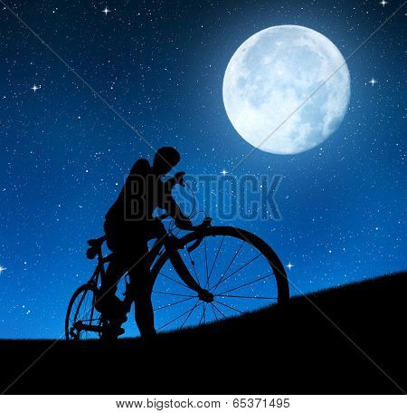 silhouette of the cyclist on a road bike in night