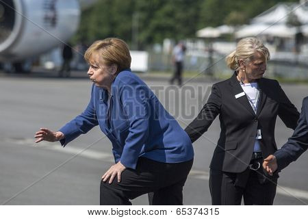 BERLIN, GERMANY - MAY 20, 2014: German Chancellor Angela Merkel (L) during open the International aviation and space exhibition ILA-2014.