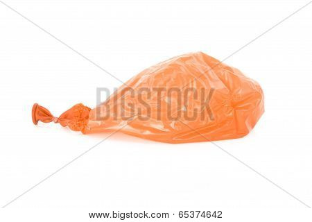 Deflated Orange Balloon Isolated Over White