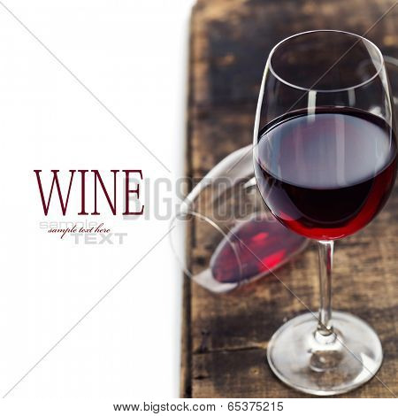 Red wine on old wooden table. With easy removable sample text