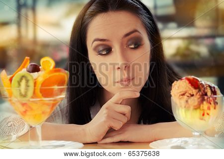 Young Woman Choosing Between Fruit Salad and Ice Cream Desserts