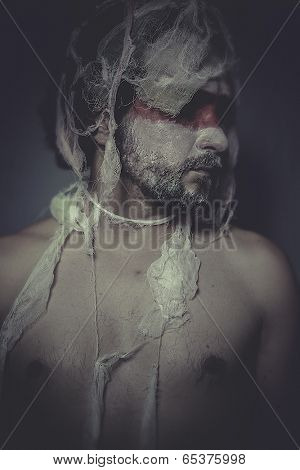 Problems, man with lace veil and bandages, wound concept, pain and suffering