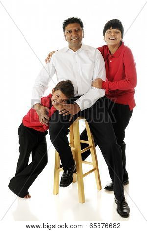 An Asian Indian man with his two biracial sons.  On a white background.