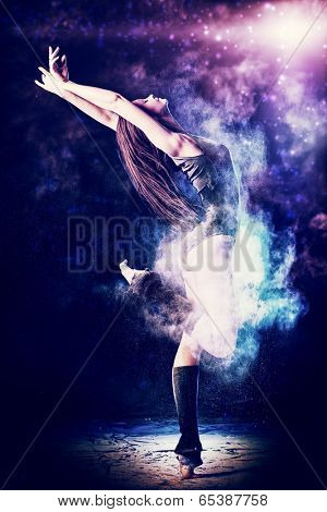 Beautiful expressive bellet dancer dancing at studio. Powder Photo Shoot.