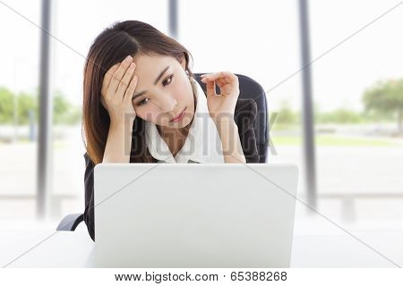 Young Business Woman Feel Tired And Holding Head
