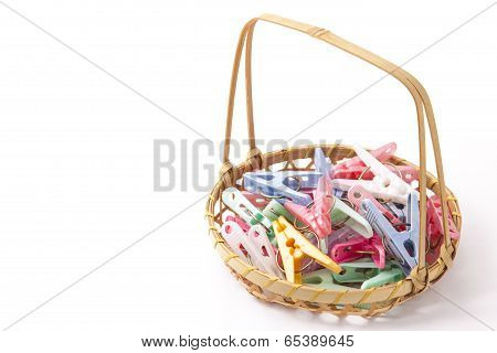 Colorful Clothespins That Were Placed In A Bamboo Basket