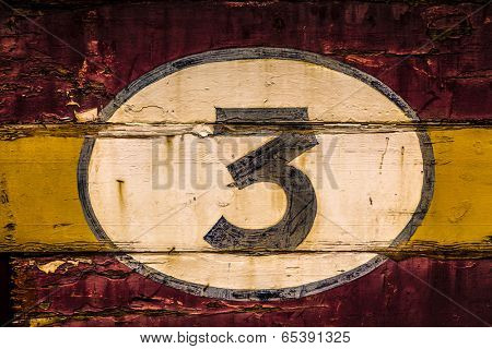 Old painted signs with  numerals. Number 3 from a series of numerals.