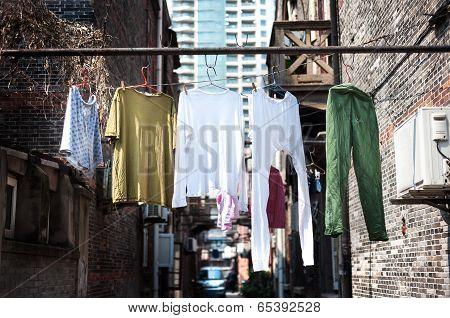 Hanging Washing In An Old Shanghai Neighbourhood