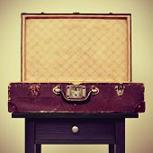 stock photo of old suitcase  - an open old suitcase on a table - JPG