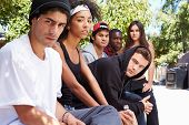 picture of gang  - Gang Of Young People In Urban Setting Sitting On Bench - JPG